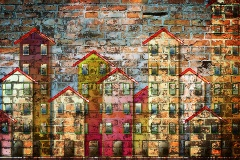 Mural of apartment housing on a brick wall.
